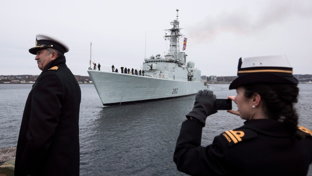 Family, veterans, and dignitaries watch as the HMCS Athabaskan makes its final sail in the Halifax Harbour during the ship's paying off ceremony in Halifax on Friday, March 10, 2017. (THE CANADIAN PRESS/Darren Calabrese)