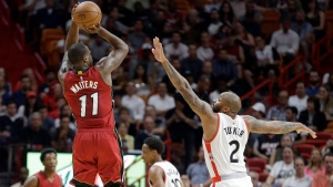 Miami Heat guard Dion Waiters (11) shoots as Toronto Raptors forward P.J. Tucker (2) defends during the first half of an NBA basketball game,  in Miami, on Saturday, March 11, 2017. (AP Photo/Alan Diaz)