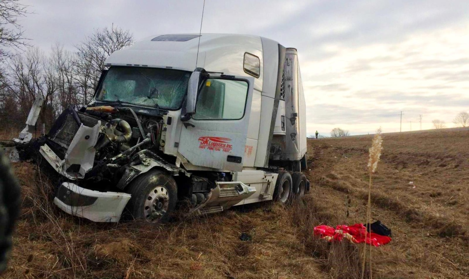 A truck driver is charged after his rig struck another transport truck from behind on the 401 on Sunday, March 12, 2017.