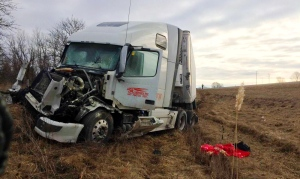 A truck driver in Ontario was charged after his rig struck another transport truck from behind on the 401 on Sunday, March 12, 2017. (Chatham-Kent OPP)