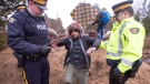 A man claiming to be from Yemen is arrested after crossing the border from New York into Canada in Hemmingford, Que. on Wednesday, March 8, 2017. (Ryan Remiorz / THE CANADIAN PRESS)