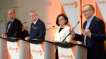 Peter Julian, right, speaks as Guy Caron, left, Charlie Angus and Niki Ashton participate in the first debate of the federal NDP leadership race, in Ottawa on Sunday, March 12, 2017. THE CANADIAN PRESS/Justin Tang