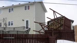 The damage from Saturday's windstorm is evident Sunday, March 12, 2017 in the St. John's metro area. Residents in Newfoundland and Labrador are taking stock of the damage caused by this Saturday's fearsome windstorm. (THE CANADIAN PRESS/Paul Daly)