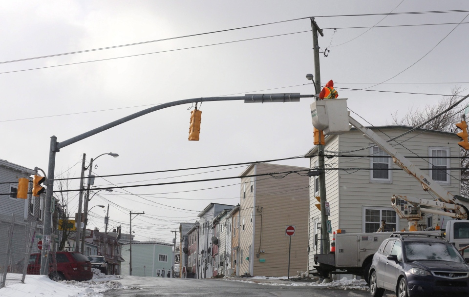 Work crews repair lights on Sunday, March 12, 2017 following Saturday's windstorm in St.John's. Residents in Newfoundland and Labrador are taking stock of the damage caused by this Saturday's fearsome windstorm. (THE CANADIAN PRESS/Paul Daly)