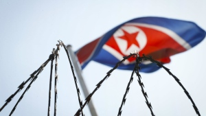 The North Korean flag is seen behind barbed wire on top of a wall at the North Korean Embassy in Kuala Lumpur, Malaysia on Thursday, March 9, 2017. (AP / Vincent Thian)