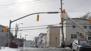 Work crews repair lights on Sunday, March 12, 2017 following Saturday's windstorm in St.John's. (Paul Daly/The Canadian Press)
