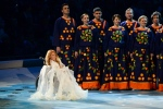 In this photo taken on Friday, March 7, 2014, Yulia Samoylova sings during the opening ceremony of the 2014 Paralympic Games in Sochi, Russia. Russian broadcaster Channel One announced on Sunday March 12, 2017, that 27-year old Yulia Samoylova, who has used a wheelchair since childhood, would represent Russia at the Eurovision contest with the song 'Flame is Burning.' (AP Photo/Ekaterina Lyzlova)