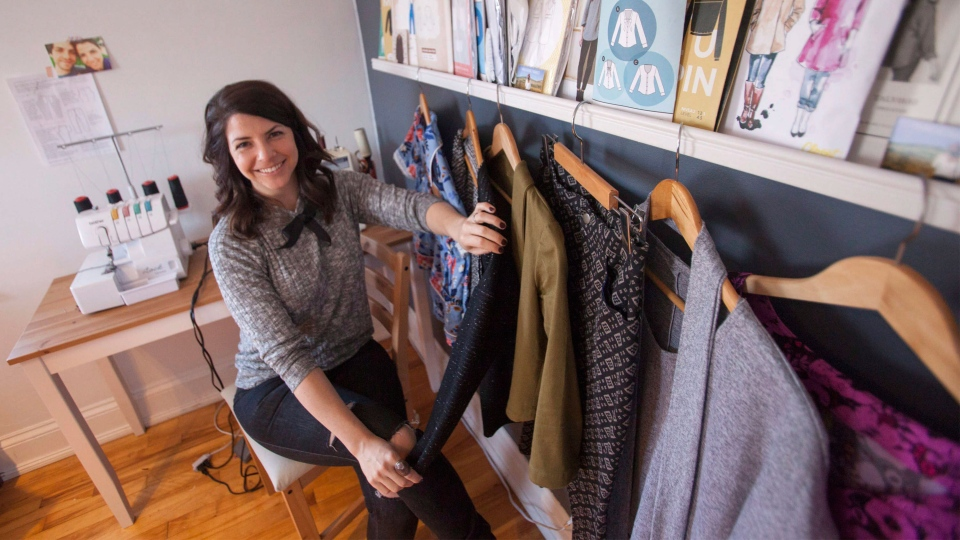 Erica Penton is seen with some of the clothes she has recently completed, in the work space in her home in Halifax on Thursday, March 9, 2017. Save for her socks, she has made all of her own clothing for the last several years. (THE CANADIAN PRESS/Stringer)
