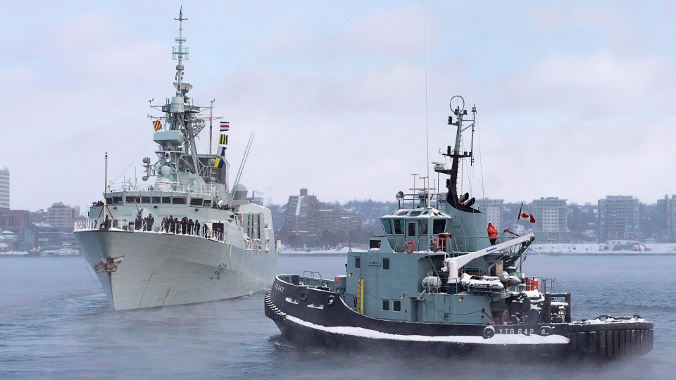 The naval tugboat Glenivis assists as HMCS St. John's heads to the Mediterranean in Halifax on Monday, Jan. 9, 2017. The Halifax-class frigate will be supporting NATO Maritime Group 2 as part of Operation Reassurance. (Andrew Vaughan/The Canadian Press)