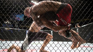 Jeremy Kennedy, left, of Surrey, B.C., throws Alessandro Ricci, of Woodbridge, Ont., as they fight during a lightweight bout during a UFC Fight Night event in Vancouver on Saturday, August 27, 2016. (Darryl Dyck/The Canadian Press)