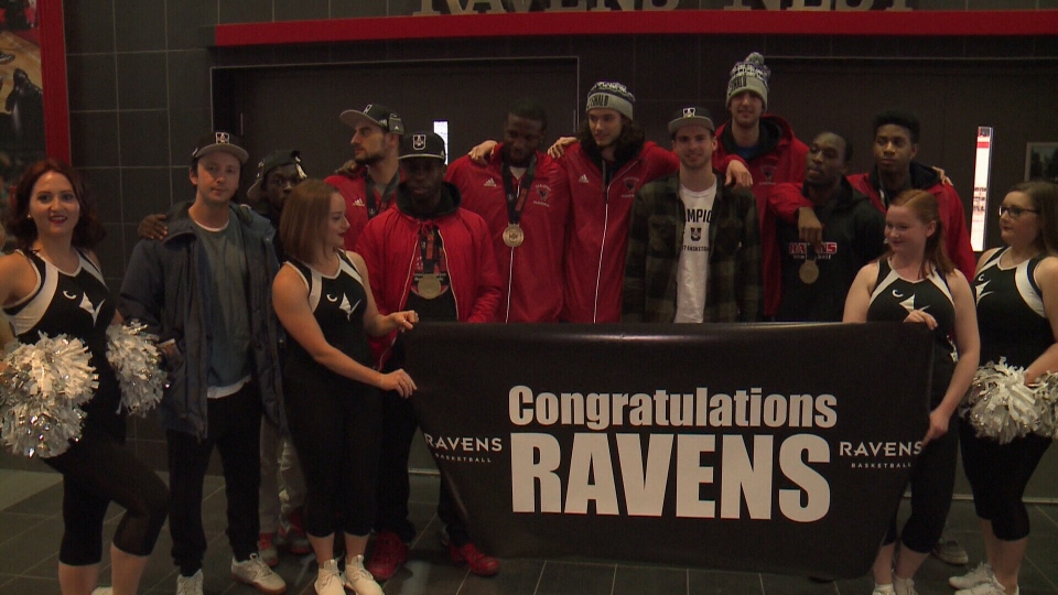 Members of the Carleton Ravens celebrate their national championship at Carleton University in Ottawa, Mar. 13, 2017