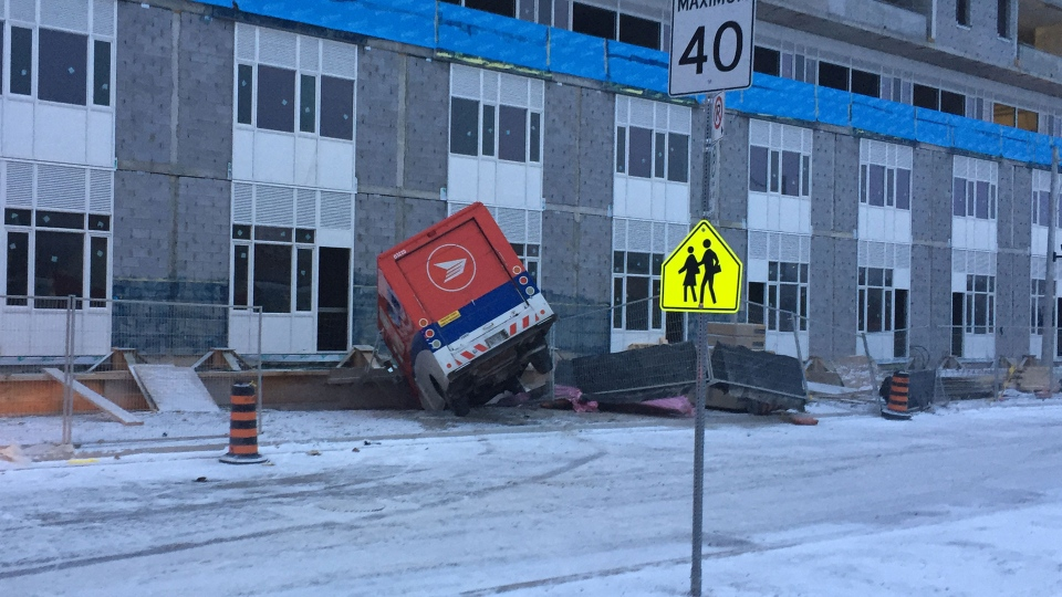 A Canada Post van is pictured after a crash on St. David Street near Regent Park Boulevard Monday March 13, 2017. (Danny Pinto /CP24)
