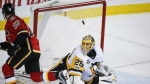 Pittsburgh Penguins goalie Marc-Andre Fleury looks on as Calgary Flames right wing Kris Versteeg scores the game-winning goal in a shoot out during NHL hockey action in Calgary on Monday, March 13, 2017. (Jeff McIntosh / THE CANADIAN PRESS)