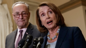 U.S. House Democratic Leader Nancy Pelosi and Senate Democratic Leader Chuck Schumer talk about the Congressional Budget Office projections for the bill dismantling Obamacare, on March, 13, 2017. (J. Scott Applewhite / AP)