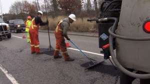 Crews in Surrey work to patch up potholes on the city's streets. (CTV)