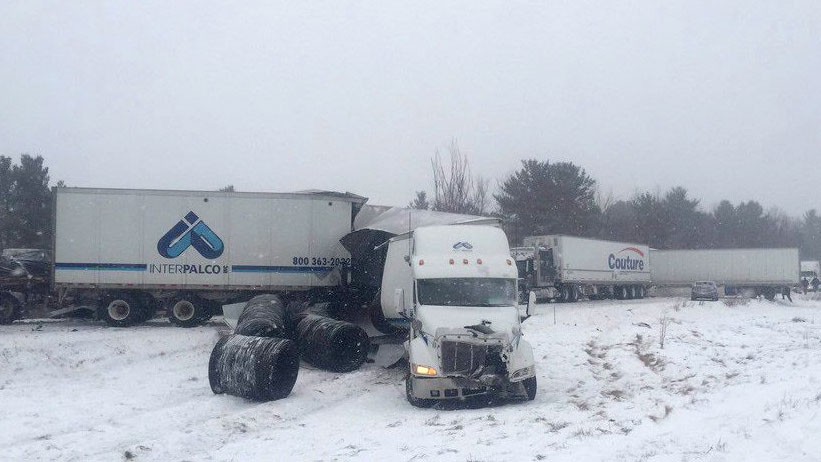 Tractor-trailers sit off the road after a crash involving at least 30 vehicles. (THE CANADIAN PRESS / HO-Twitter-XBR_Traffic)