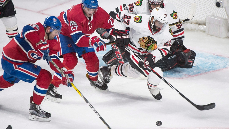 Chicago Blackhawks' Johnny Oduya (27) and Montreal Canadiens' Alexander Radulov, left, and Alex Galchenyuk chase down a loose puck during second period NHL hockey action in Montreal, Tuesday, March 14, 2017. THE CANADIAN PRESS/Graham Hughes