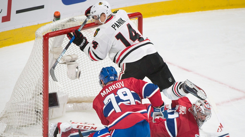 Chicago Blackhawks' Richard Panik (14) moves in on Montreal Canadiens goalie Carey Price as Canadiens' Andrei Markov defends during second period NHL hockey action in Montreal, Tuesday, March 14, 2017. THE CANADIAN PRESS/Graham Hughes