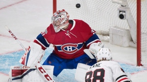Patrick Kane scores on Carey Price in Montreal on Tuesday March 14, 2017 (THE CANADIAN PRESS/Graham Hughes)