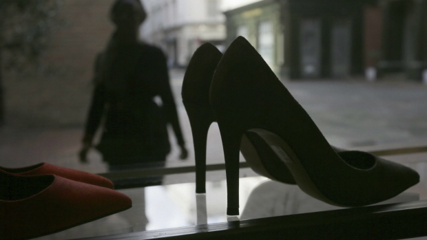 A person looks at high heels on display at the Pretty Small Shoes store in Bloomsbury, London on Monday, March 6, 2017. (AP / Tim Ireland)