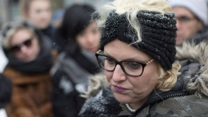 Mandi Gray stands with supporters as she talks with media outside court in Toronto, as Mustafa Ururyar appeals his conviction and sentence on the sexual assault of Ms. Gray, in this photo taken on Tuesday, March 14, 2017. (Chris Young / THE CANADIAN PRESS)