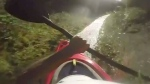Daredevils kayak down drainage ditch