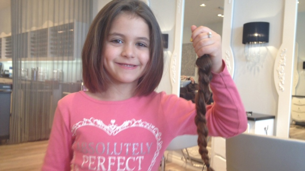 6 year old girl gets first haircut to help cancer patient - Voila institute of hair design kitchener ...