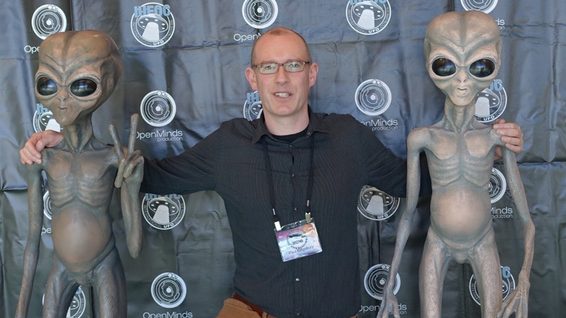 SFU geography professor Paul Kingsbury poses at the International UFO Congress. (Provided)