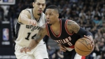 Portland Trail Blazers guard Damian Lillard drives around San Antonio Spurs guard Danny Green during the second half of an NBA basketball game in San Antonio on Wednesday, March 15, 2017. (AP / Eric Gay)