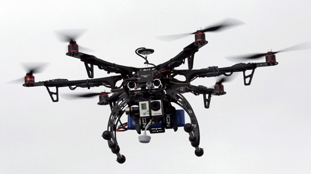 In this Feb. 13, 2014, file photo, a drone is demonstrated in Brigham City, Utah. (AP Photo/Rick Bowmer, File)