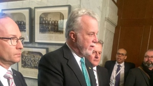 Quebec Premier Philippe Couillard, flanked by Public Security Minister Martin Coiteux and Transport Minister Laurent Lessard (photo: CTV Montreal / Maya Johnson)