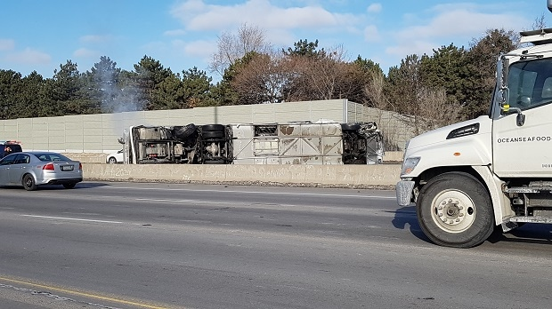 A bus rollover prompted OPP to close the westbound collector lanes of Highway 401 near Allen Rd. on March 16, 2017. (Peter Mills/CP24)