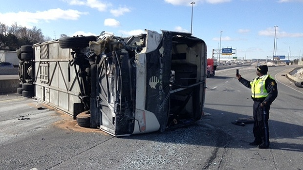 OPP investigate a bus rollover on Highway 401 near Allen Rd. on March 16, 2017. (Cam Woolley/CP24)