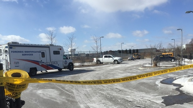 Police are investigating after a body was found lying in a Scarborough parking lot on March 16, 2017.