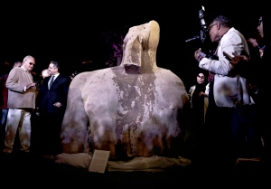 Egyptian Antiquities Minister Khaled el-Anani, second left, talks near a stone part of the statue of King Psamtek l after a press conference at the Egyptian museum in Cairo, Thursday, March 16, 2017. (AP / Nariman El-Mofty)