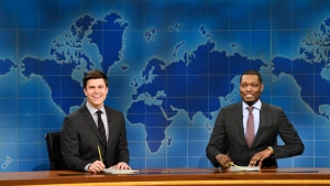 """In this March 4, 2017 photo provided by NBC, Colin Jost and Michael Che, right, appear during Weekend Update segment of """"Saturday Night Live"""" in New York. (Will Heath/NBC via AP)"""