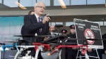 Transport Minister Marc Garneau announces new safety restrictions on recreational drones at Billy Bishop airport in Toronto on Thursday March 16, 2017. THE CANADIAN PRESS/Frank Gunn