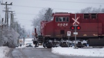 A Canadian Pacific Railway train passes through a crossing on a rural road in Delta, B.C., on Sunday, Feb. 5, 2017. (Darryl Dyck/THE CANADIAN PRESS)