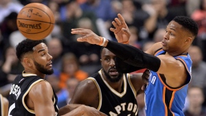 Oklahoma City Thunder guard Russell Westbrook (0) moves the ball past Toronto Raptors guard Cory Joseph (6) and Toronto Raptors forward Patrick Patterson (54) during first half NBA basketball action, in Toronto on Thursday, March 16, 2017. THE CANADIAN PRESS/Nathan Denette