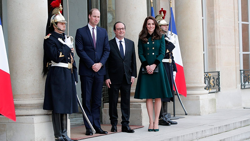 French President Francois Hollande, center, welcomes Prince William with Kate, Duchess of Cambridge at the Elysee Palace in Paris, Friday March 17, 2017. Prince William and his wife Kate are coming to Paris to meet the French president as Britain gets ready to launch divorce proceedings from the European Union. (AP Photo/Christophe Ena)