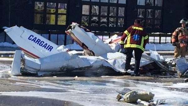 Two airplanes collided over the Promenade St-Bruno on Friday, causing one to crash into the mall's parking lot and the other onto the roof. (Photo via Nathalie Lussier)
