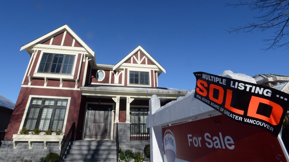 A real estate sold sign is shown outside a house in Vancouver, Tuesday, Jan.3, 2017. (Jonathan Hayward / THE CANADIAN PRESS)