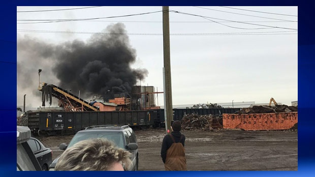 A plume of smoke erupts from the Calgary Metal Recycling Inc. yard on Friday afternoon (photo: DonateRecycleIT)