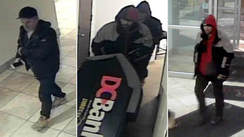 Police released stills taken from surveillance footage showing two suspects making off with an ATM from a hotel on 53 Ave. and Calgary Trail on March 11, 2017. Supplied.