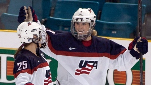 Team United States' Monique Lamoureux, right, celebrates her goal against Team Finland with teammate Alex Carpenter during the third period at the Four Nations Cup women's hockey tournament in Kamloops, British Columbia. (AP Photo/The Canadian Press, Jeff Bassett, File)