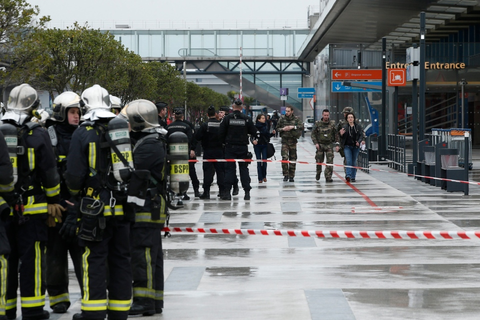 Police officers, rescue workers, left, and soldiers patrol outside the Orly airport , south of Paris, Saturday, March, 18, 2017. (AP Photo/Thibault Camus)