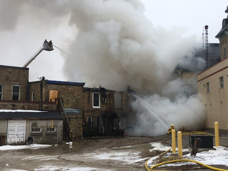 Firefighters in Clinton continue to battle a fire at the main intersection of the town on Saturday, March 18, 2017. They are trying to keep the fire from spreading to the town hall next door. (Nadia Matos / CTV Kitchener)
