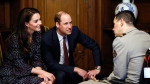 Kate, the Duchess of Cambridge and Britain's Prince William listen to wounded French army members as they visit the Hotel des Invalides in Paris, Saturday, March 18, 2017. (Gonzalo Fuentes, Pool via AP)