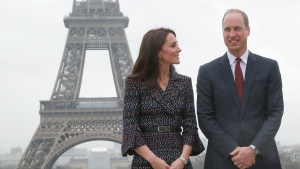Britain's Prince William, the Duke of Cambridge, and his wife Kate, the Duchess of Cambridge, pose for photographers with the Eiffel tower in Paris, France, Saturday, March 18, 2017. (AP Photo/Michel Euler, Pool)