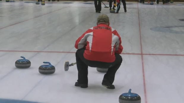 A curler was sent to hospital Friday after suffering what is believed to be a heart attack during a match in the Travelers Provincial Curling Championship.
